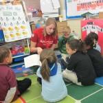 Emily Baseler reads to pre-school children.