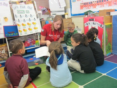 Emily Baseler reads to pre-school children.