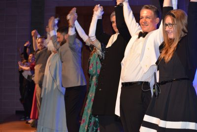 """TCPCG faculty and students celebrate after the performance of """"The Importance of Being Earnest."""""""