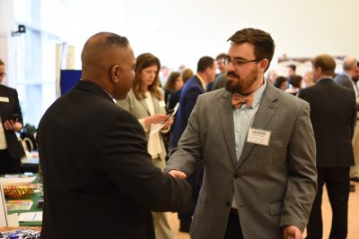 Neag education student, Kyle MacSuga, greets a school district representative during the career fair.