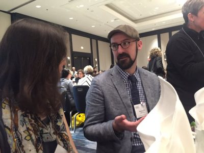 Neag doctoral student, T.J. McKenna, discusses research with conference attendee.