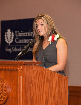 Kimberly Ruiz accepts the 2012 Outstanding Educator Award at the Neag Alumni Society Awards Dinner. (Photo: Tom Hurlburt/Neag School)