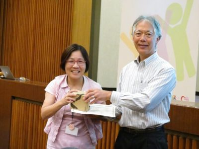 Li-Yu Hung, professor in the Department of Special Education at National Taiwan Normal University in Taipei City and host of the Conference, greets George Sugai.