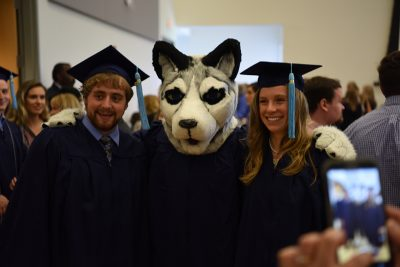 Class of 2017 Graduates with Jonathan the Husky Mascot