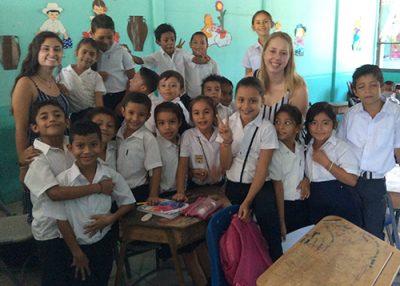 Neag School students Kelsey Iwanickiand Emily Baseler with schoolchildren in Costa Rica
