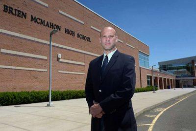 Alum Scott Hurwitz outside of Brien McMahon High in Norwalk, Conn.
