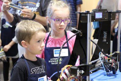 Two children taking part in Science Salon Junior event