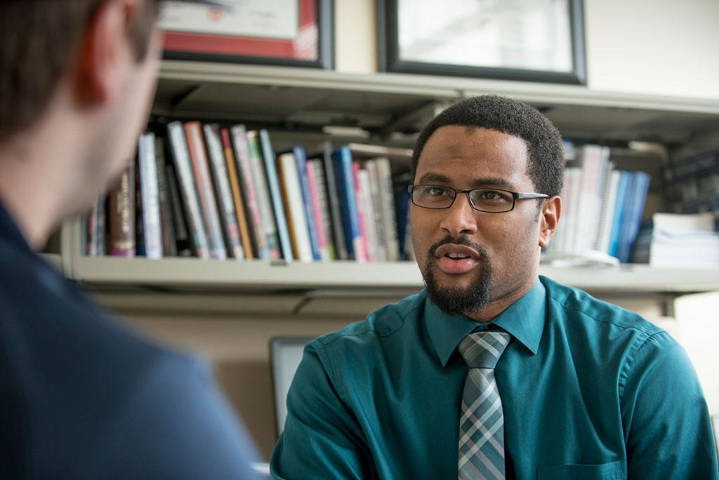 Joseph Cooper meets with student