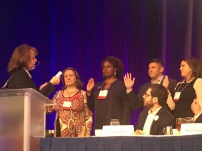Bianca Montrosse-Moorhead is sworn in as a board member-at-large during the American Evaluation Association annual conference.