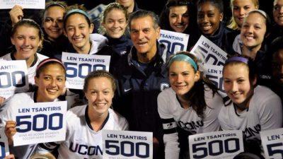 Len Tsantiris celebrates win with UConn Women's soccer.