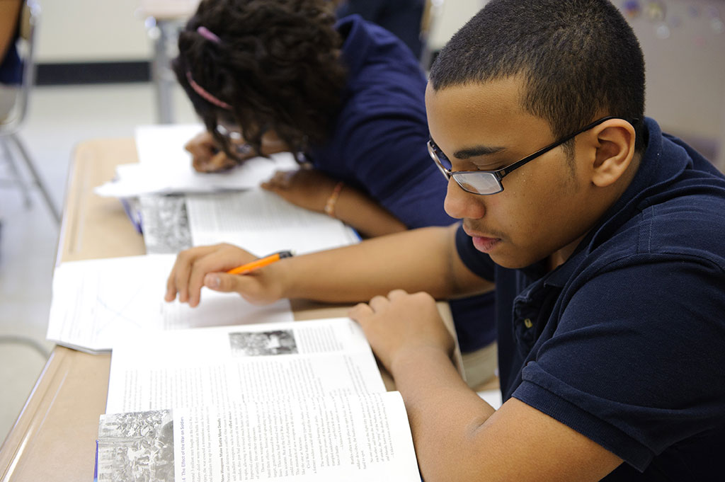 Students in class at the Renzulli Academy in Hartford, Conn., for children in Grades 4-8. (Peter Morenus/UConn Photo)