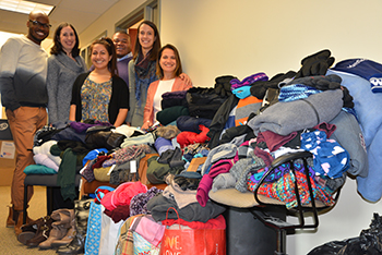 Faculty, staff, and students from the HESA program gathered with the donated items.
