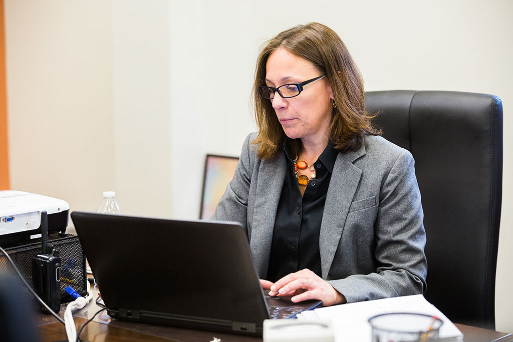 6:20 a.m. — Megan Baker, principal at Tourtellotte Memorial High School in Thompson, Conn., starts off her day an hour before the school day, which begins at 7:20 a.m. She spends the time reviewing emails, preparing for the day, and gathering with her team. (Photo Credit: Cat Boyce)