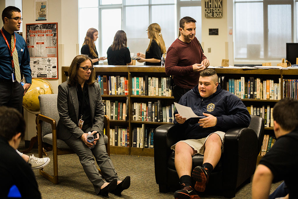 11:00 a.m. — Baker and student leader Matt Grauer discuss findings from a student leadership survey during the weekly leadership meeting in the school's library. (Photo credit: Cat Boyce/Neag School)