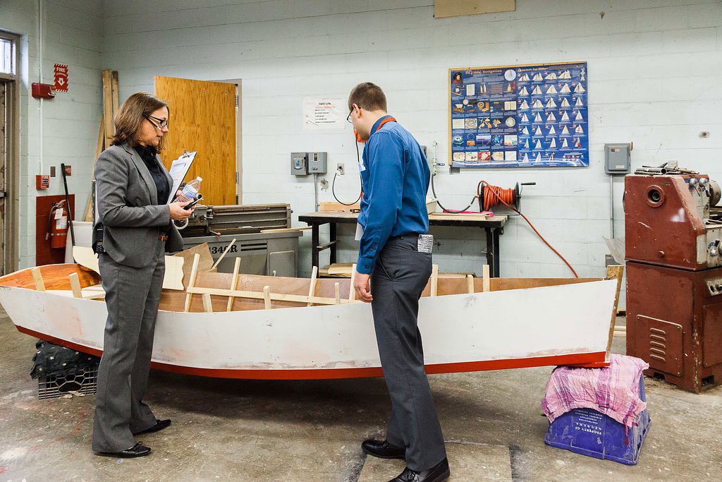 11:30 a.m. — Baker shows Angelo a boat building project, the first of its kind for the school. (Photo credit: Cat Boyce/Neag School)