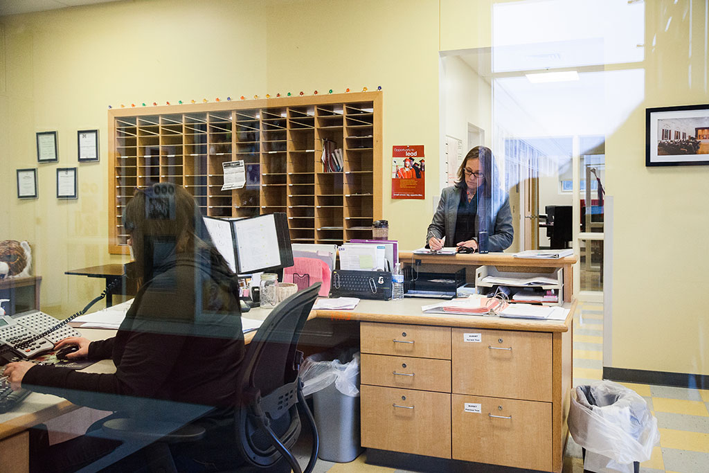 1:00 p.m. — Baker checks in at the office and confirms her afternoon schedule. (Photo credit: Cat Boyce/Neag School)