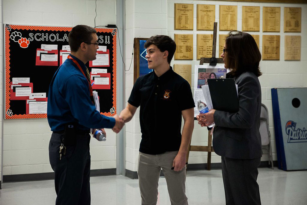 7:10 a.m.— Baker introduces Matt Angelo to Alex Rooney, a senior and future Neag School student, before the school day starts. (Photo credit: Cat Boyce/Neag School)