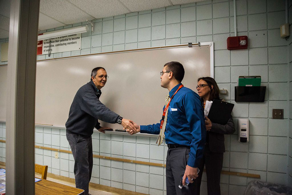 7:45 a.m. — Angelo greets computer science teacher and Neag School alumnus Tony Perault XX, before the morning lecture. (Photo credit: Cat Boyce/Neag School)
