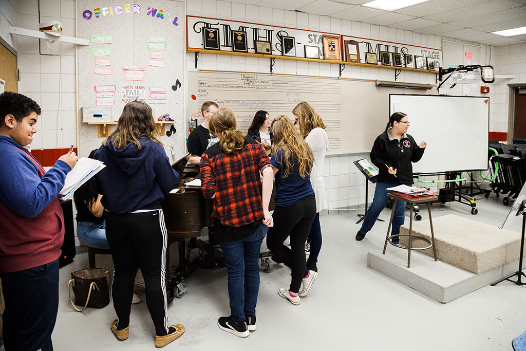 9:00 a.m. — Students in the Modern Music Ensemble class practice for a community performance, lead by Neag School alumna, Kate Anderson, pictured on the right. (Photo credit: Cat Boyce/Neag School)