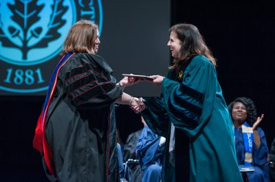 Catherine Little receives her Honors Advisor of the Year award from Jennifer Lease Butts, director of UConn's Honors Program.