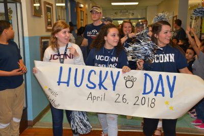 Neag School students lead the Husky Day parade.