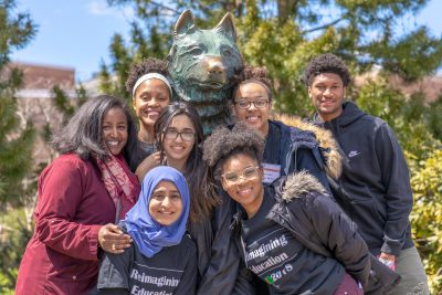 Student leaders from LID gather at the Husky statue.