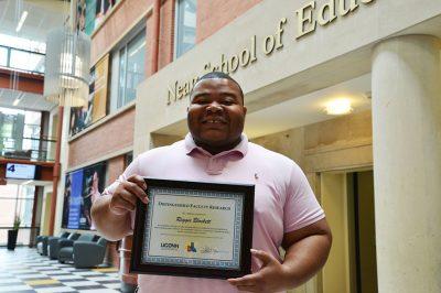 Reggie Blockett with his award.