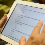 A view of an iPad with Khmer language questionnaire. (Peter Morenus/UConn Photo)