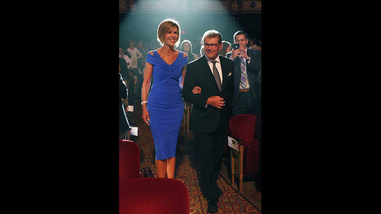 Chris Dailey, left, is escorted by Geno Auriemma at the Women's Basketball Hall of Fame induction ceremony in Knoxville, Tenn., this June. (Photo credit: Lisa Hudson/Courant)