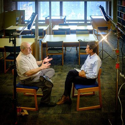 James Kaufman, professor of educational psychology, is interviewed by CNN's Sanjay Gupta at the Home Babbidge Library on July 28, 2015. (Peter Morenus/UConn Photo)