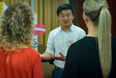 Photo caption: Ellijah Tateishi, shares his insights on available resources, with Ann Traynor, director of advising and certification, and René Roselle, interim director for teacher education.