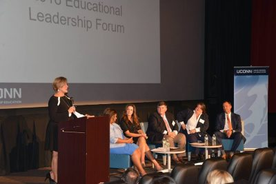 Sarah Barzee, chief talent officer with the Connecticut State Department of Education (CSDE) and Executive Leadership Program alumna, gives welcoming remarks. Also pictured are panelistsPatricia Garcia, Windham Public Schools superintendent; Lisa Lamenzo, CSDE turnaround bureau chief and current UCAPP student; Jim Messina, Clinton Public Schools literacy specialist and current UCAPP student; Jennifer Michno, Neag School clinical instructor and UCAPP alumna; and Nathan D. Quesnel, East Hartford Public Schools superintendent and IB/M alumnus.