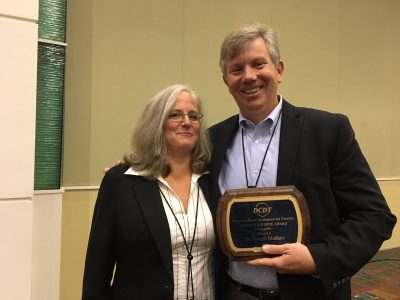 Joseph Madaus receives the Oliver P. Kolstoe Award from the Council for Exceptional Children's Division on Career Development and Transition. Also pictured is Valeria Mazzotti from the University of North Carolina-Charlotte, and president of DCDT.