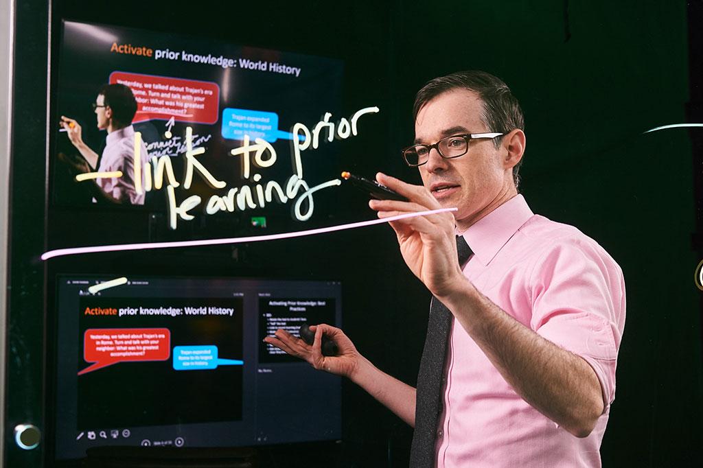 Devin Kearns uses Lightboard Technology. (Peter Morenus/UConn)
