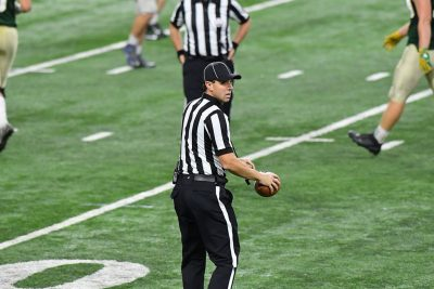 Justin Paluch '12 (BUS, ED) officiated the Michigan High School Athletic Association Division 6 State Football Final this season. He also officiates DII college football and DI, DII, and DIII women's basketball. (Photo courtesy of Justin Paluch)