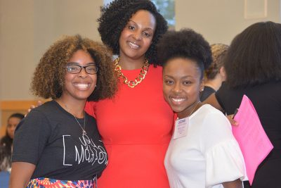 Alumna Tracey-Ann Lafayette, left; Mia Hines, academic advisor in the Neag School, center; and alumna Symone James attend the Neag School's 2018 Celebration of Diversity in Education Dinner. (Shawn Kornegay/Neag School)