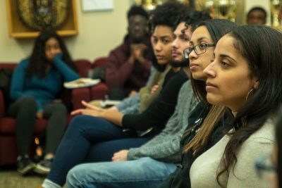 Students listen in on Joseph Cooper's remarks at an event held last month to celebrate the release of his book, <i>From Exploitation Back to Empowerment</i>. (Eve Lenson/Neag School)