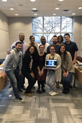 Graduate students in counselor education, including Lorenzo Chavez Jasmine Morel, Amanda Perrault, Katrina Zaciek, and Emily Sears, along with assistant professor Erik Hines, Melanie Banks, Johnny Banks, Tyler Burley, Kimberly Traverso, and Aaron Gilberto, gathered at UConn's School of Social Work in February to recognize National School Counseling Week. (Photo courtesy of Erik Hines)