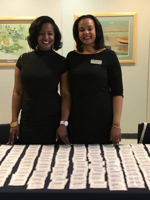 Dominique Battle-Lawson and Mia Hines, academic advisors in the Neag School, greet guests at the Education Career Fair.