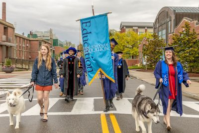 The Neag School Class of 2019 undergraduates process with Jonathans XIII and XIV from the Gentry Building to the Jorgensen Center for the Performing Arts. (Frank Zappulla/Neag School)