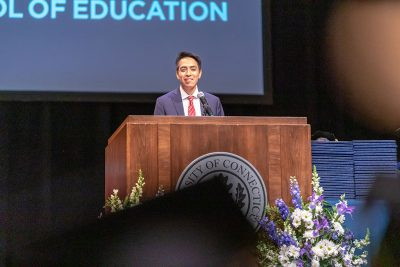 Jesús Cortés-Sanchez '18 (ED), '19 MA tells the Class of 2019 his personal story. (Frank Zappulla/Neag School)