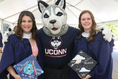 Neag School graduate students from the Class of 2019 celebration with Jonathan the Husky mascot at the Student Union. (GradImages)