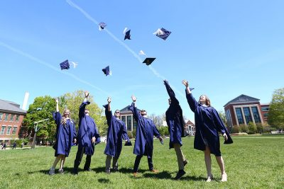 Neag School Class of 2019 graduate students celebrate outside of the Student Union this May. (GradImages)