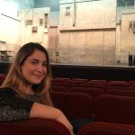 "Alexandra Eckhardt takes a rare break between shows on the Broadway set of ""The Band's Visit."""
