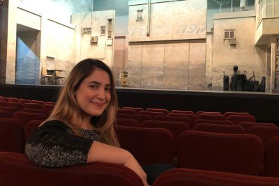 "Eckhardt takes a rare break between shows on the Broadway set of ""The Band's Visit."" Courtesy of Alexandra Eckhardt"
