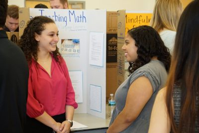 Photo caption: Students from the IB/M program shared their inquiry projects during the IB/M Master's Day of Research.