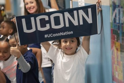 First-grader holds sign at 2019 Kennelly UConn Day.