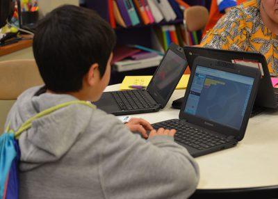 Student looking at computer.
