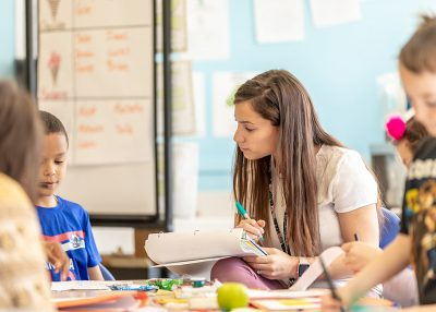 Aryliz (Crespo) Estrela '16 (ED), '17 MA listens to one of her second-grade students at Bowers Elementary School in Manchester, Conn.