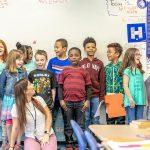 Students at Bowers Elementary School with their teacher, alum Aryliz Estrela.